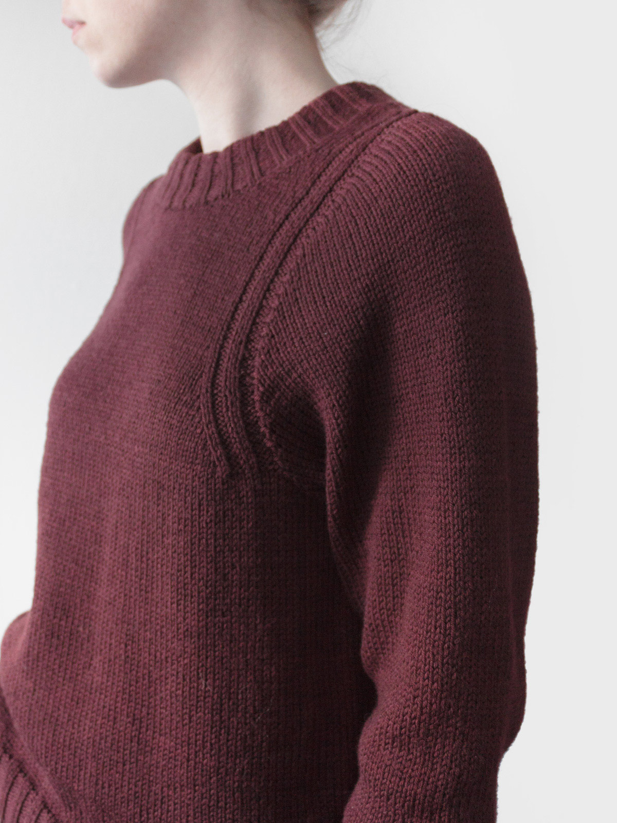 close-up of curved, deep armhole shaping
