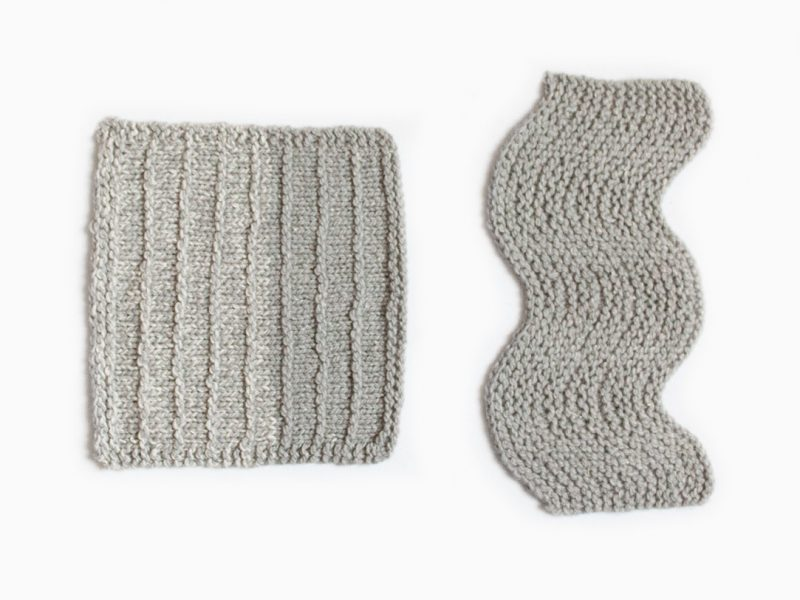 knitted swatches in grey yarn