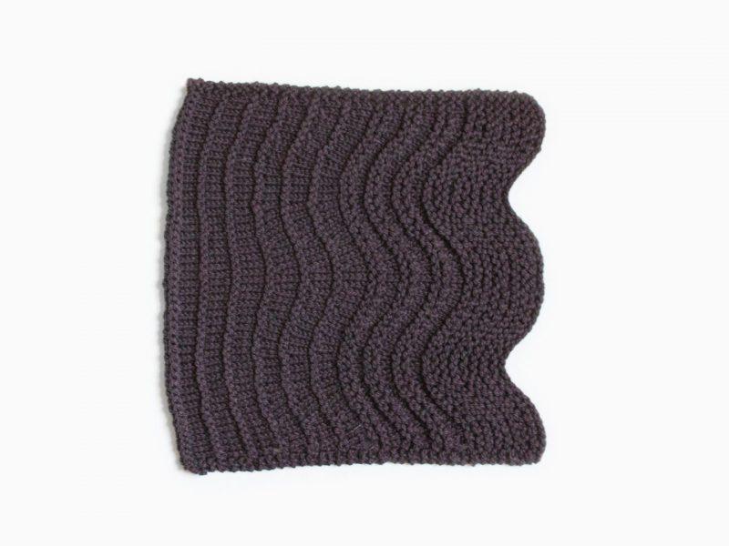 knitted swatch in dark yarn